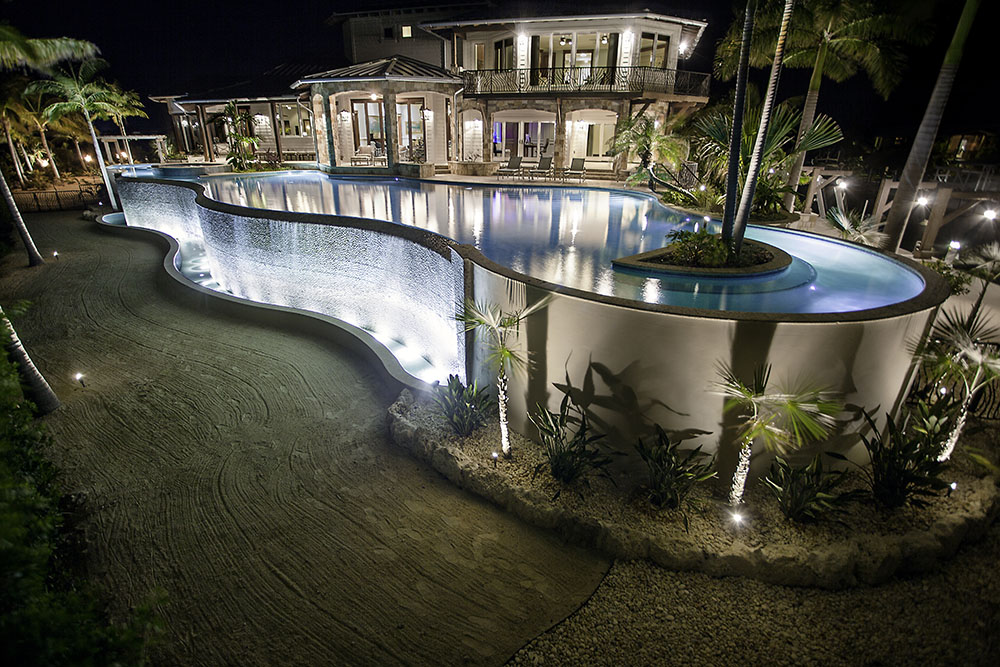 D'Asign Raised Pool at night