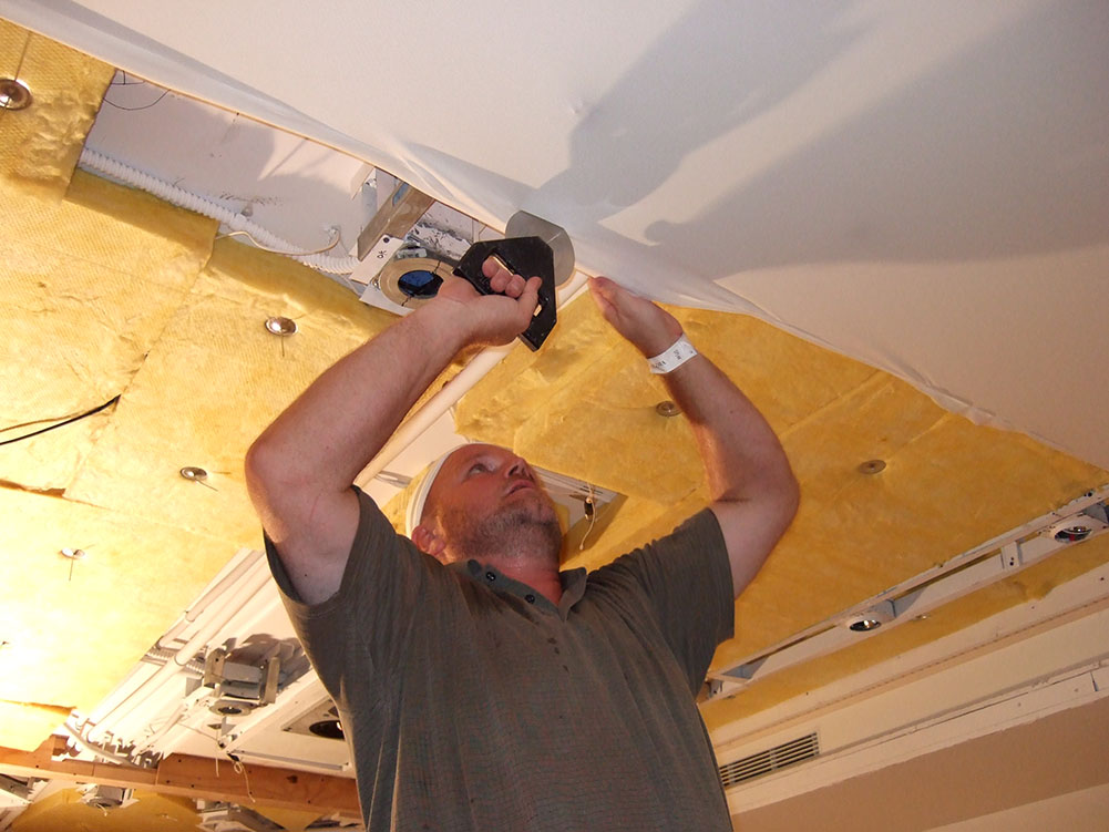 Installation of stretched fabric ceiling