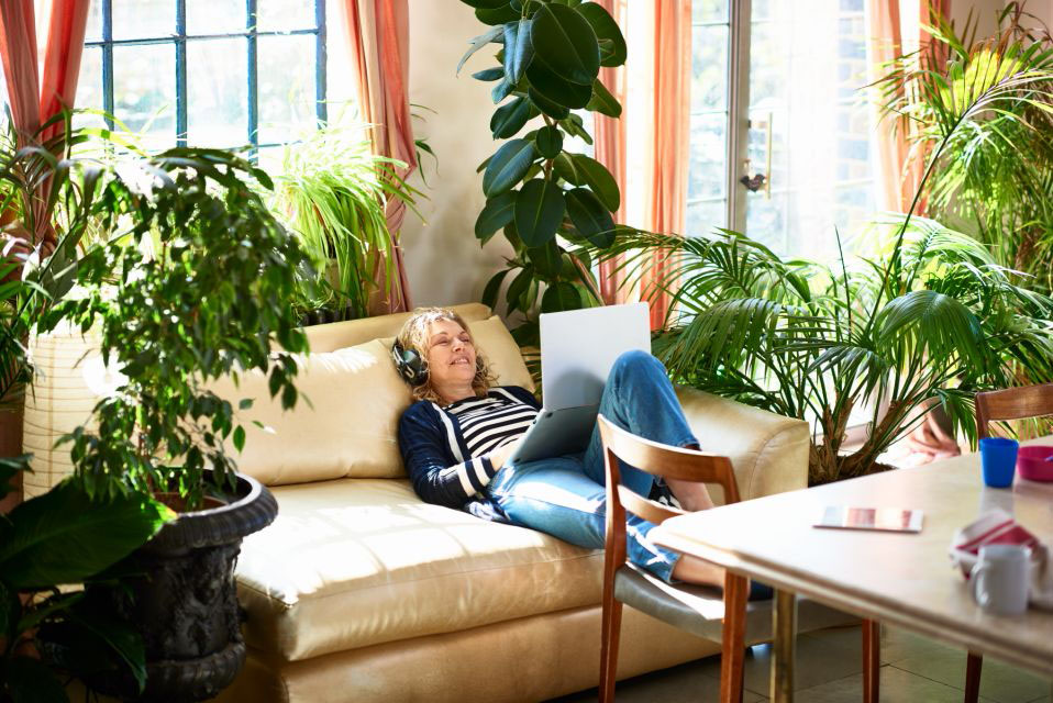 Air-purifying plants - woman on couch