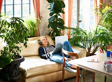 Air Purifying plants woman on couch