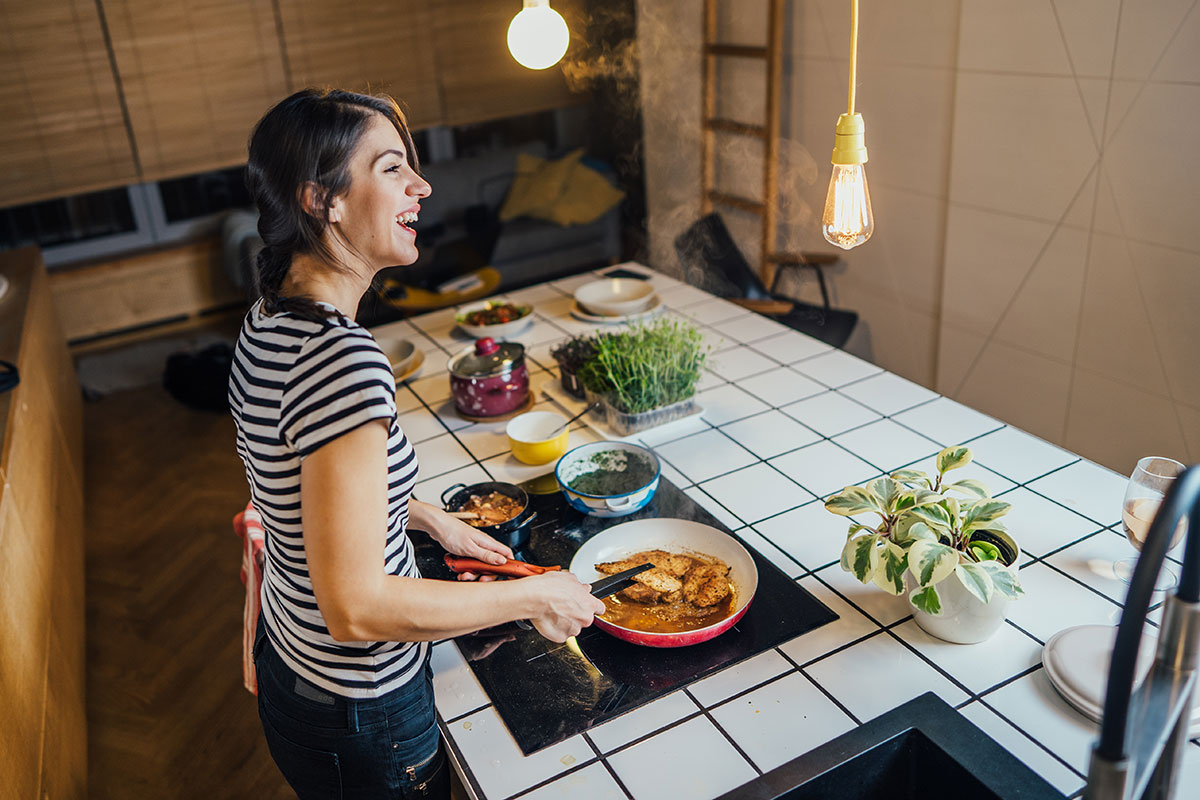 woman at induction cooktop